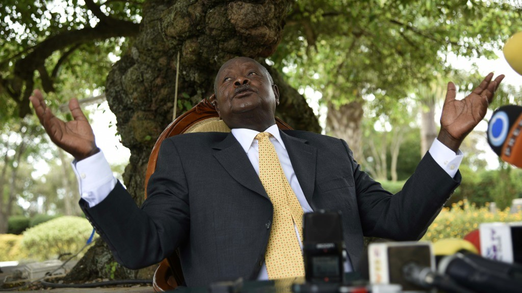 Newly re-elected president Yoweri Museveni, in power since three decades, gestures as he speaks during a press conference at his country house in Rwakitura, about 275 kilometres west of the capital Kampala on February 21, 2016. Uganda's veteran leader was declared the winner of the country's presidential election with 60 percent of the vote on February 20, far ahead of the 35 percent won by detained opposition chief Kizza Besigye, whose house was surrounded by police in riot gear as the results were announced. Uganda's presidential election was marred by chaos as the Electoral Commission failed to deliver the voting materials to most of the Kampala based polling stations. / AFP PHOTO / Isaac Kasamani