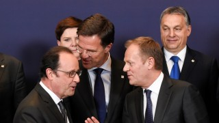 Lithuanian Prime minister Dalia Grybauskaite, French President of Republic Francois Hollande talks with Dutch Prime minister Mark Rutte and EU Council President Donald Tusk and Hungary Prime minister Viktor Orban (BackR)  during the European Union summit in Brussels on March 17, 2016, where 28 EU leaders will discuss the ongoing refugee crisis.  / AFP PHOTO / JOHN THYS