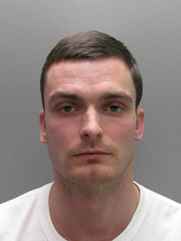 """(FILES) A file handout photograph released by Durham Police on March 2, 2016, shows former Sunderland footballer Adam Johnson posing for his custody photograph at a police station in north east England.  RESTRICTED TO EDITORIAL USE - MANDATORY CREDIT  """" AFP PHOTO / DURHAM POLICE """"  -  NO MARKETING NO ADVERTISING CAMPAIGNS   -   DISTRIBUTED AS A SERVICE TO CLIENTS    Adam Johnson was sentenced to six years in prison at Bradford Crown Court on Thursday March 24, 2016, for engaging in sexual activity with a 15-year-old fan.  / AFP PHOTO / DURHAM POLICE / HANDOUT"""
