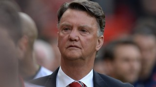 Manchester United's Dutch manager Louis van Gaal arrives for the English Premier League football match between Manchester United and Everton at Old Trafford in Manchester, north west England, on April 3, 2016. / AFP PHOTO / OLI SCARFF / RESTRICTED TO EDITORIAL USE. No use with unauthorized audio, video, data, fixture lists, club/league logos or 'live' services. Online in-match use limited to 75 images, no video emulation. No use in betting, games or single club/league/player publications.  /