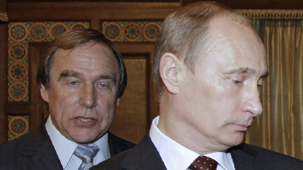 """A picture taken on November 21, 2009 shows then Russia's Prime Minister Vladimir Putin (front) and Russian cellist Sergei Roldugin, artistic director of the St. Petersburg House of Music, visiting the house, formerly a palace owned by Grand Duke Alexei Romanov, in St. Petersburg. A Russian cellist who stays out of politics, Sergei Roldugin has called his friend Vladimir Putin a de-facto """"brother"""". Now the """"Panama Papers"""" leak, analysed by Russian journalists, puts him at the top of an offshore empire worth more than $2 billion that has made Putin's circle fabulously wealthy. / AFP PHOTO / Sputnik / DMITRY ASTAKHOV / """"The erroneous mention appearing in the metadata of this photo by DMITRY ASTAKHOV has been modified in AFP systems in the following manner: [then Russia's President Vladimir Putin] instead of [then Russia's Prime Minister Vladimir Putin]. Please immediately remove the erroneous mention from all your online services and delete it from your servers. If you have been authorized by AFP to distribute it to third parties, please ensure that the same actions are carried out by them. Failure to promptly comply with these instructions will entail liability on your part for any continued or post notification usage. Therefore we thank you very much for all your attention and prompt action. We are sorry for the inconvenience this notification may cause and remain at your disposal for any further information you may require."""""""