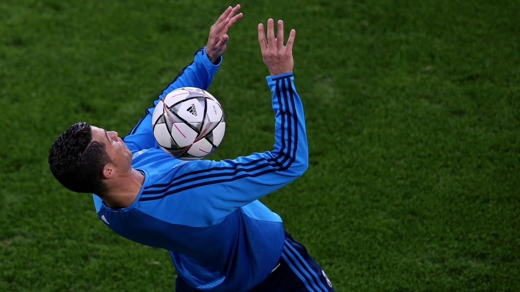 Real Madrid's Portuguese forward Cristiano Ronaldo controls the ball during a press conference at the Volkswagen Arena on the eve of the UEFA Champions League quarter-final, first-leg football match between VfL Wolfsburg and Real Madrid on April 5, 2016 in Wolfsburg, central Germany.  / AFP PHOTO / Ronny Hartmann