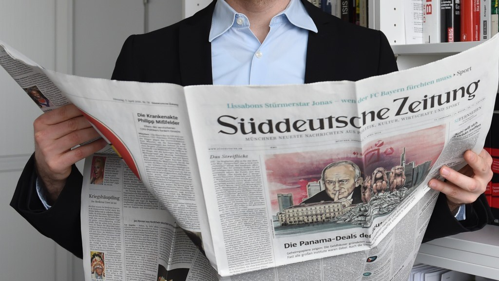 """German journalist Frederik Obermaier co-author of the socalled """"Panama Papers"""" investigation poses on April 7, 2016 in Munich, southern Germany, at his office at the German daily """"Sueddeutsche Zeitung"""". The Panama Papers are a massive leak of 11.5 million documents allegedly exposing the secret offshore dealings of aides to Russian president Vladimir Putin, world leaders and celebrities including Barcelona striker Lionel Messi. The vast stash of records was obtained from an anonymous source by German daily Sueddeutsche Zeitung and shared with media worldwide by the International Consortium of Investigative Journalists (ICIJ).  / AFP PHOTO / CHRISTOF STACHE"""