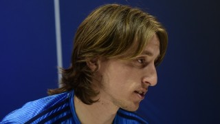 Real Madrid's Croatian midfielder Luka Modric sits during a press conference at Valdebebas Sport City in Madrid on April 11, 2016 on the eve of their Champions League second leg football match against Wolfsburg.   / AFP PHOTO / PIERRE-PHILIPPE MARCOU