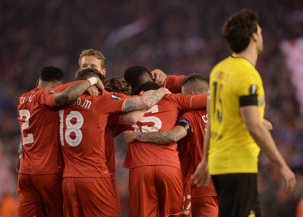 Liverpool players celebrate after winning the UEFA Europa league quarter-final second leg football match between Liverpool and Borussia Dortmund at Anfield stadium in Liverpool on April 14, 2016. / AFP PHOTO / OLI SCARFF