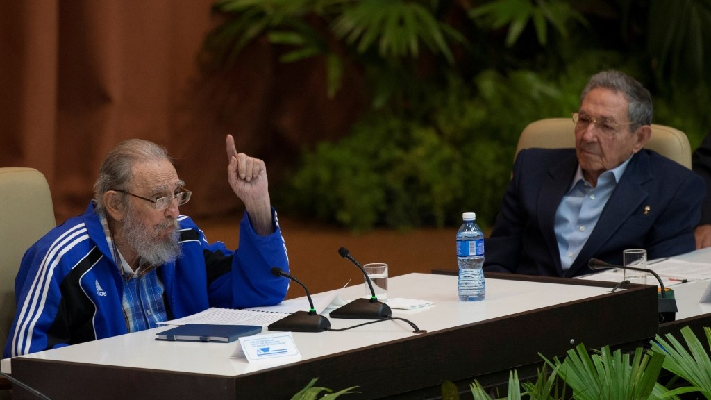 """Handout picture released by Cuban official website www.cubadebate.cu showing Cuban former President Fidel Castro (L) speaking next to Cuban President Raul Castro during the closing ceremony of VII Congress of the Cuban Communist Party (PCC) at the Convention Palace in Havana, on April 19, 2016. """"Cuba will never permit the application of so-called shock therapies, which are frequently applied to the detriment of society's most humble classes,"""" said Raul Castro in a lengthy speech opening the congress, which takes place every five years and will stretch on for several days. / AFP PHOTO / ACN / ISMAEL FRANCISCO / RESTRICTED TO EDITORIAL USE - MANDATORY CREDIT """"AFP PHOTO / WWW.CUBADEBATE.CU / ISMAEL FRANCISCO"""" - NO MARKETING NO ADVERTISING CAMPAIGNS - DISTRIBUTED AS A SERVICE TO CLIENTS"""