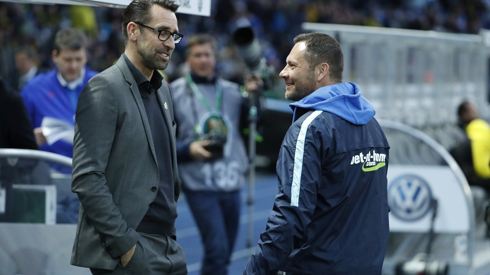 Hertha's Hungarian head coach Pal Dardai (R) and  Hertha's manager Michael Preetz chat prior to the German Cup (DFB Pokal) semi-final football match Hertha Berlin v Borussia Dortmund at the Olympic stadium in Berlin on April 20, 2016.    / AFP PHOTO / ODD ANDERSEN / RESTRICTIONS: ACCORDING TO DFB RULES IMAGE SEQUENCES TO SIMULATE VIDEO IS NOT ALLOWED DURING MATCH TIME. MOBILE (MMS) USE IS NOT ALLOWED DURING AND FOR FURTHER TWO HOURS AFTER THE MATCH. == RESTRICTED TO EDITORIAL USE == FOR MORE INFORMATION CONTACT DFB DIRECTLY AT +49 69 67880   /