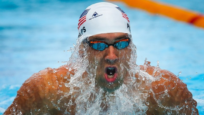 FILES) This file photo taken on August 24, 2014 shows Micheal Phelps of the US competing during the Men's 200 m Individual Medley heat at the Gold Coast Aquatic Centre,Gold Coast. / AFP PHOTO / PATRICK HAMILTON