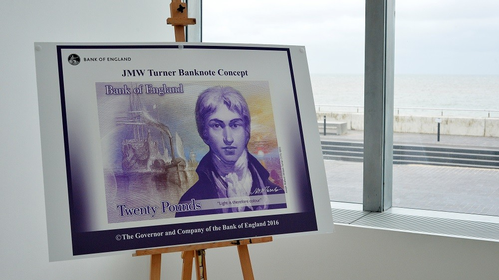 The design for a new British 20 pound note featuring an artwork by British artist JMW Turner enitled 'The Fighting Temeraire tugged to her last Berth to be broken up' (1839)is pictured during a media facility in Margate, south-east England on April 22, 2016.                                                                                             / AFP PHOTO / POOL / GLYN KIRK