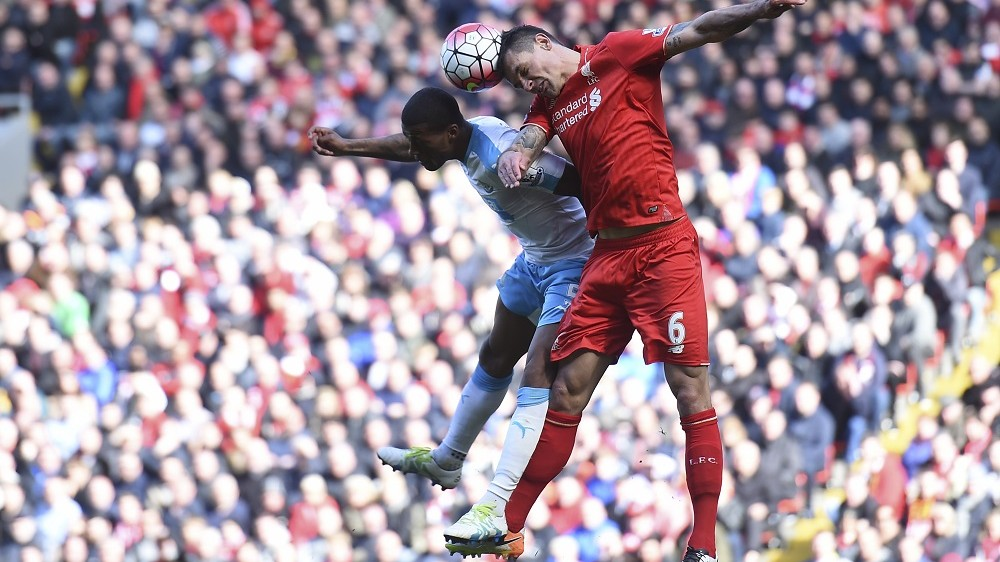 Liverpool's Croatian defender Dejan Lovren (R) beats Newcastle United's Dutch midfielder Georginio Wijnaldum (L) to a header during the English Premier League football match between Liverpool and Newcastle United at Anfield in Liverpool, north west England on April 23, 2016. / AFP PHOTO / PAUL ELLIS / RESTRICTED TO EDITORIAL USE. No use with unauthorized audio, video, data, fixture lists, club/league logos or 'live' services. Online in-match use limited to 75 images, no video emulation. No use in betting, games or single club/league/player publications.  /