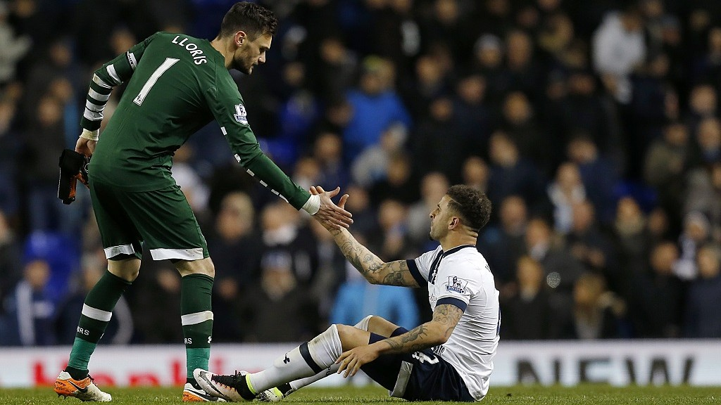 Tottenham Hotspur's French goalkeeper Hugo Lloris (L) helps Tottenham Hotspur's English defender Kyle Walker to his feet at the final whistle after a 1-1 draw during the English Premier League football match between Tottenham Hotspur and West Bromwich Albion at White Hart Lane in London, on April 25, 2016. / AFP PHOTO / IKimages / RESTRICTED TO EDITORIAL USE. No use with unauthorized audio, video, data, fixture lists, club/league logos or 'live' services. Online in-match use limited to 75 images, no video emulation. No use in betting, games or single club/league/player publications.  /