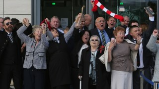 Relatives of the victims of the 1989 Hillsborough disaster react following the conclusion of the inquest into the disaster, at the coroner's court in Warrington, north-west England on April 26, 2016. The 96 Liverpool fans who died in Britain's 1989 Hillsborough football stadium disaster were unlawfully killed, a jury found Tuesday following the longest-running inquest in English legal history. After hearing more than two years of evidence, the jury also concluded that the behaviour of Liverpool supporters on the day did not cause or contribute to Britain's worst sports stadium tragedy.  / AFP PHOTO / GEOFF CADDICK