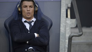 Real Madrid's Portuguese forward Cristiano Ronaldo sits in the dug-out ahead of kick off of the UEFA Champions League semi-final first leg football match between Manchester City and Real Madrid at the Etihad Stadium in Manchester, northwest England, on April 26, 2016. Real Madrid superstar Cristiano Ronaldo was unexpectedly left out of the squad for his side's Champions League semi-final first leg at Manchester City on April 26. Ronaldo was declared fit by head coach Zinedine Zidane on April 25, despite having missed Saturday's 3-2 win at Rayo Vallecano with a thigh strain, and trained with his team-mates on the eve of the game. But he was not even included in the squad to face City, with Spanish winger Lucas Vazquez taking his place in the starting XI at the Etihad Stadium.  / AFP PHOTO / OLI SCARFF