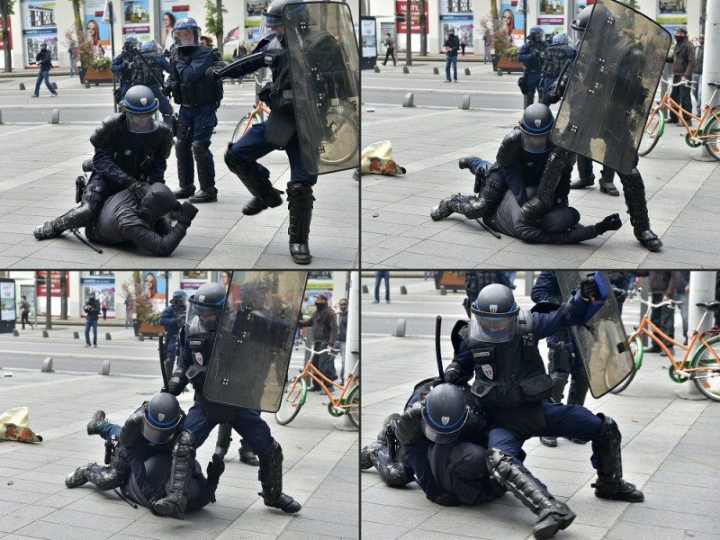 (COMBO) This combination of pictures created on April 28, 2016 shows riot police arresting a protester during a demonstration against the French government's proposed labour reforms on April 28, 2016 in Nantes.    / AFP PHOTO / LOIC VENANCE