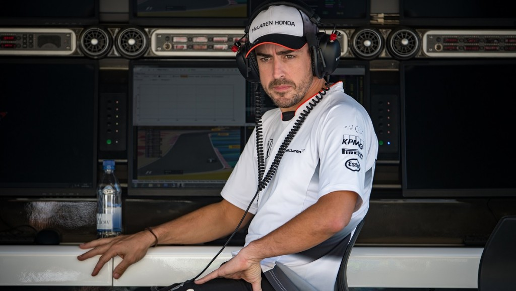McLaren Honda's Spanish driver Fernando Alonso sits at his team engineers stand during the third practice session at the Sakhir circuit in Manama on April 2, 2016 ahead of the Bahrain Formula One Grand Prix.  AFP PHOTO / ANDREJ ISAKOVIC / AFP PHOTO / ANDREJ ISAKOVIC