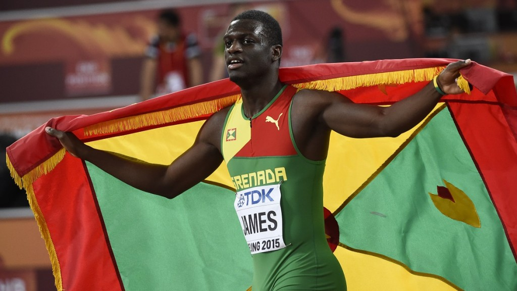 """Grenada's Kirani James celebrates after finishing third in the final of the men's 400 metres athletics event at the 2015 IAAF World Championships at the """"Bird's Nest"""" National Stadium in Beijing on August 26, 2015.  AFP PHOTO / FRANCK FIFE / AFP PHOTO / FRANCK FIFE"""