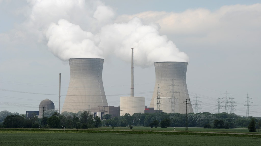 Power poles stand next to the cooling towers of the nuclear power plant in Gundremmingen, southern Germany, on June 3, 2011. The German cabinet is to decide on June 6, 2011 on a bill phasing out nuclear power in Europe's biggest economy by 2022, prompted by the disaster in March 2011 at Japan's Fukushima plant.      AFP PHOTO/CHRISTOF STACHE / AFP PHOTO / CHRISTOF STACHE