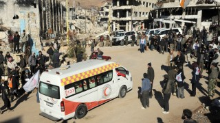 """A picture released by the official Syrian Arab News Agency (SANA) shows Syrians gathering around an ambulance of the Syrian Red Crescent in the flashpoint Syrian border town of Zabadani before the departure of a convoy that will cross into Lebanon as part of a UN-backed truce on December 28, 2015. The convoy, carrying more than 120 rebels and wounded from Zabadani, included seven buses and 22 ambulances and was accompanied by Lebanese security forces from the Masnaa border crossing, the journalist at the scene said.  AFP PHOTO / SANA / HO  ===RESTRICTED TO EDITORIAL USE - MANDATORY CREDIT """"AFP PHOTO / HO / SANA"""" - NO MARKETING NO ADVERTISING CAMPAIGNS - DISTRIBUTED AS A SERVICE TO CLIENTS === / AFP PHOTO / SANA / -"""