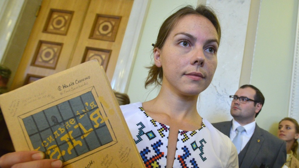 Vira Savchenko holds the book written in prison by her sister Nadiya during its presentation at the Ukrainian Parliament in Kiev on September 16, 2015. Ukrainian military pilot Nadiya Savchenko, charged with the murder of two journalists in Russia was symbolically elected MP on the list of Batkivchtchina Party (Homeland) of former Prime Minister Yulia Tymoshenko.  A Russian court on September 15, 2015 said Nadiya Savchenko will go on trial next week over the murder of two Russian journalists, and ruled that she must stay behind bars meanwhile.AFP PHOTO/GENYA SAVILOV / AFP PHOTO / GENYA SAVILOV