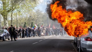FRANCE, Nantes: A Porsche car is on fire as hundreds demonstrate against the French government's proposed labour law reforms on April 28, 2016 in Nantes, western France. High school pupils and workers protest against deeply unpopular labour reforms that have divided the Socialist government and raised hackles in a country accustomed to iron-clad job security. - Thomas GIRONDEL
