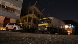 SYRIA, Saqba: A truck, part of a long-awaited United Nations convoy, stands beside a blown-up building in Saqba, just east of Damascus, Syria on March 4, 2016. The fleet of trucks will reportedly deliver food and medical supplies to close to 20,000 in Saqba and nearby Ein Tarma, as the United Nations Humanitarian Affairs in Syria, the Syrian Arab Red Crescent, and the International Committee of the Red Cross continue their efforts to help those in need. - CITIZENSIDE/ Msallam Abdalbaset