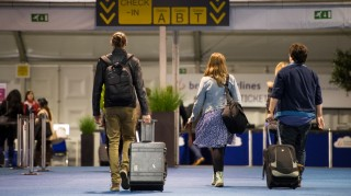 Passengers arrive at the new temporary check-in site at Brussels Airport in Zaventem, Monday 04 April 2016. Since yesterday the airport has partially restarted. In the morning of Tuesday 22nd of March two bombs exploded in the departure hall of Brussels Airport and another one in the Maelbeek - Maalbeek subway station, which made around 35 deadly victims, not including the suicide bombers, and 340 injured people in total. ISIL (Islamic State of Iraq and the Levant - Daesh - ISIS) claimed responsibility for these attacks. BELGA PHOTO LAURIE DIEFFEMBACQ