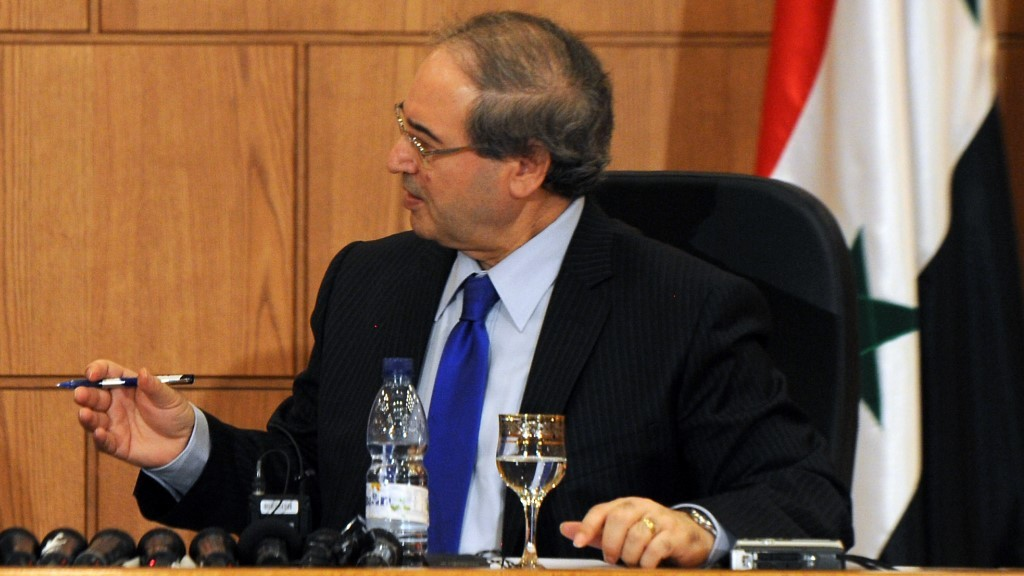 (150903) -- DAMASCUS, Sept. 3, 2015 (Xinhua) -- Syrian Deputy Foreign Minister Faisal Mekdad (R) and visiting Iranian Deputy Foreign Minister Hussein Abdul Lahyan attend a joint press conference in Damascus, capital of Syria, on Sept. 3, 2015. Visiting Iranian Deputy Foreign Minister Hussein Abdul Lahyan said Thursday that the Syrian leadership has welcomed an initiative proposed recently by Tehran to help bring a political end to the long-running Syrian conflict. (Xinhua/Zhang Naijie)