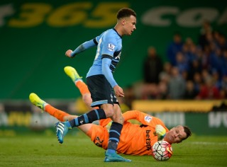 Dele Alli of Tottenham Hotspur has Stoke City Goalkeeper Shay Given beat for his second goal but hits the post during the Barclays Premier League match between Stoke City and Tottenham Hotspur played at the Britannia Stadium, Stoke, England, on April 18, 2016 - Photo Joe Toth / BPI / DPPI