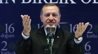 """ISTANBUL, TURKEY - APRIL 17: Turkey's President Recep Tayyip Erdogan (C) gives a speech during a conference on """"Prophet Muhammad, Tawhid and Wahdat"""" as a part of the Holy Birth Week celebrations, at Sinan Erdem Sports Hall in Istanbul, Turkey on April 17, 2016. The Holy Birth Week dedicated to mark the holy birth of Muslims' beloved Prophet Muhammad, has been commemorated in Turkey since 1989 with lectures, workshops, and scholarly meetings to draw attention to the life of Prophet Muhammad and his teachings. Muslims in Turkey celebrate the week with joy and anticipation as they venerate Prophet Muhammad and his message to all. The Prophet Muhammad's birth day is 20th of April AD 571. Turkish Presidency / Yasin Bulbul / Anadolu Agency"""