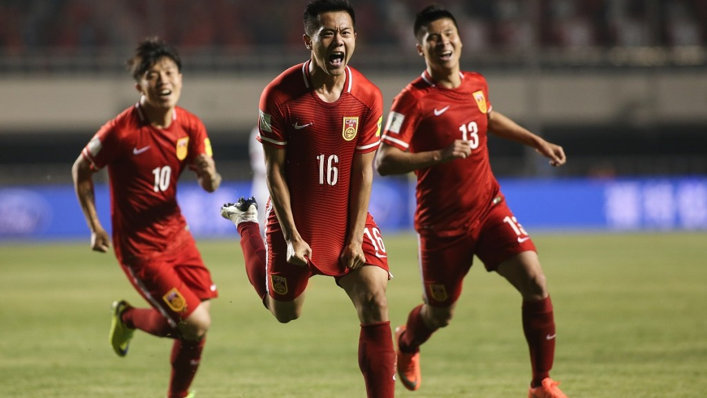 XI AN, CHINA - MARCH 29:  (CHINA OUT) Huang Bowen #16 of China celebrates after scoring his team's first goal during the FIFA 2018 World Cup Qualifier match between China and Qatar at Shaanxi Province Stadium on March 29, 2016 in Xi An, China.  (Photo by VCG/VCG via Getty Images)