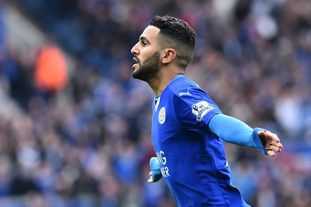 Leicester City's Algerian midfielder Riyad Mahrez celebrates scoring the opening goal during the English Premier League football match between Leicester City and Swansea at King Power Stadium in Leicester, central England on April 24, 2016. / AFP PHOTO / BEN STANSALL / RESTRICTED TO EDITORIAL USE. No use with unauthorized audio, video, data, fixture lists, club/league logos or 'live' services. Online in-match use limited to 75 images, no video emulation. No use in betting, games or single club/league/player publications.  /