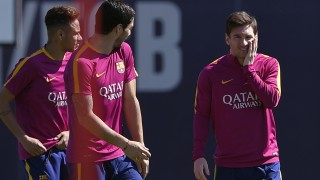 Barcelona's Argentinian forward Lionel Messi (R), Barcelona's Brazilian forward Neymar (L) and Barcelona's Uruguayan forward Luis Suarez (C) take part in a training session at the FC Barcelona Joan Gamper Sports Center in Sant Joan Despi, near Barcelona on April 16, 2015, on the eve of the Spanish League match FC Barcelona vs Valencia CF. / AFP PHOTO / LLUIS GENE