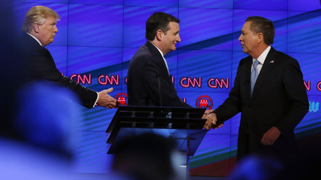 Donald Trump (L), Texas Senator Ted Cruz (C) and Ohio Governor John Kasich (R) shake hands following the CNN Republican Presidential Debate March 10, 2016 in Miami, Florida. / AFP PHOTO / RHONA WISE