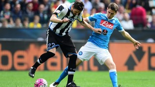 Napoli's midfielder from Brazil Jorginho (R) fights for the ball with Udinese's midfielder from Serbia Zdravko Kuzmanovic during the Italian Serie A football match Udinese vs Napoli at Friuli Stadium in Udine on April 3, 2016.   / AFP / GIUSEPPE CACACE