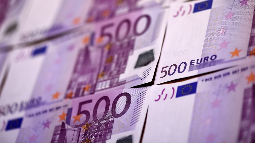 "This illustration picture taken on February 12, 2016 in Paris shows several 500 Euro notes displayed in an arrangement.  The European Central Bank will take a decision soon on whether to keep printing 500-euro banknotes, with the arguments for doing so becoming ""less and less convincing"", a top-ranking official said on February 11, 2016. / AFP PHOTO / MIGUEL MEDINA"