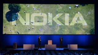 Nokia CEO Rajeev Suri (R) speaks during a press conference on the eve of the official start of the Mobile World Congress in Barcelona on February 21, 2016.  The world's biggest mobile fair, Mobile World Congress, is held from February 22 to February 25. / AFP PHOTO / JOSEP LAGO