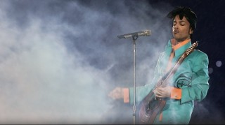 """(FILES) This file photo taken on February 4, 2007 shows US musician Prince performing during half-time at Super Bowl XLI at Dolphin Stadium in Miami between the Chicago Bears and the Indianapolis Colts.    A woman claiming to be Prince's half-sister has come forward saying she is entitled to part of the late pop star's multimillion-dollar estate, legal documents show. Darcell Gresham Johnston filed court documents April 29, 2016 in the musician's probate case in Minnesota saying she is an """"interested party and beneficiary"""" in the singer's estate. The """"Purple Rain"""" star died leaving no will and had no children or living parents. The estate was previously expected to be equally split six ways between Prince's known surviving siblings under Minnesota law.  / AFP PHOTO / Roberto SCHMIDT"""
