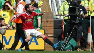 Manchester United's Spanish midfielder Juan Mata (L) celebrates scoring his team's first goal during the English Premier League football match between Norwich City and Manchester United at Carrow Road in Norwich, eastern England, on May 7, 2016.   / AFP PHOTO / JUSTIN TALLIS