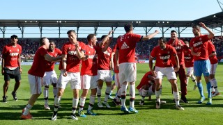 Bayern Munich players celebrate wining the league for the fourth year in a row after the German first division Bundesliga football match between FC Ingolstadt 04 and FC Bayern Munich, at the Audi Sportpark in Ingolstadt, southern Germany, on May 7, 2016. / AFP PHOTO / CHRISTOF STACHE / RESTRICTIONS: DURING MATCH TIME: DFL RULES TO LIMIT THE ONLINE USAGE TO 15 PICTURES PER MATCH AND FORBID IMAGE SEQUENCES TO SIMULATE VIDEO. == RESTRICTED TO EDITORIAL USE == FOR FURTHER QUERIES PLEASE CONTACT DFL DIRECTLY AT + 49 69 650050