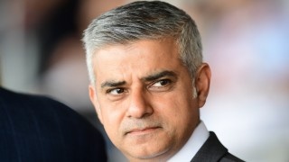 """Britain's new London Mayor Sadiq Khan attends the Yom HaShoah Commemoration, the UK Jewish community's Holocaust remembrance ceremony, in Barnet, north London, on May 8, 2016. London's new Muslim mayor Sadiq Khan accused Prime Minister David Cameron on Sunday of using """"Donald Trump playbook"""" tactics to try to divide communities in a bid to prevent his election. Khan won 57 percent of the vote in the May 5 mayoral election, securing 1.3 million votes to see off multimillionaire Tory Zac Goldsmith and making history as the first Muslim mayor of a major Western capital. / AFP PHOTO / LEON NEAL"""