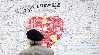 A man looks at a memorial panel for the victims of the March 22 attacks at the entrance of the Maelbeek-Maalbeek subway station in Brussels on May 11, 2016. On March 22, 2016, two bombs exploded in the departure hall of Brussels Airport and another one in the Maelbeek - Maalbeek subway station, leaving 31 people dead and 250 injured. Islamic State group (IS) claimed responsibility for the attacks. / AFP PHOTO / Belga / LAURIE DIEFFEMBACQ / ALTERNATIVE CROP