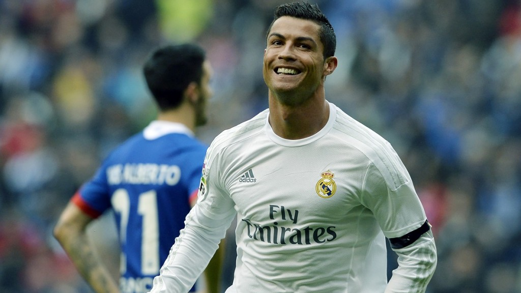 Real Madrid's Portuguese forward Cristiano Ronaldo celebrates after scoring a goal during the Spanish league football match RC Deportivo de la Coruna vs Real Madrid at the Riazor stadium in Coruna on May 14, 2016. / AFP PHOTO / MIGUEL RIOPA