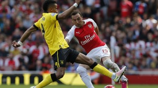 Aston Villa's English midfielder Scott Sinclair (L) vies with Arsenal's Spanish midfielder Santi Cazorla during the English Premier League football match between Arsenal and Aston Villa at the Emirates Stadium in London on May 15, 2016.  / AFP PHOTO / IAN KINGTON / RESTRICTED TO EDITORIAL USE. No use with unauthorized audio, video, data, fixture lists, club/league logos or 'live' services. Online in-match use limited to 75 images, no video emulation. No use in betting, games or single club/league/player publications.  /