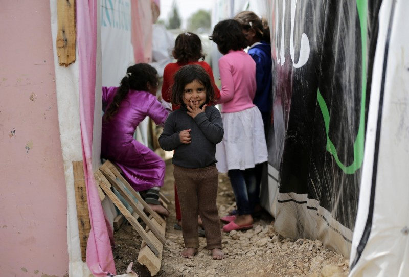 Syrian refugee children play at an unofficial refugee camp in Lebanon's town of Bar Elias in the Bekaa Valley on May 13, 2016. Five years into the Syria conflict, Lebanon hosts more than one million refugees from the war-torn country, according to the United Nations. More than a third live in the Bekaa valley near the Syrian border. As towns there strive to accommodate tens of thousands of Syrian arrivals, some local councils are struggling to provide them with burial services because town cemeteries are almost full. / AFP PHOTO / JOSEPH EID / TO GO WITH AFP STORY BY ALICE HACKMAN