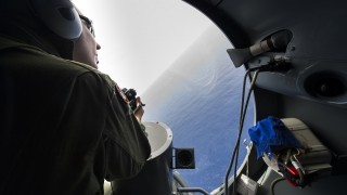 """This handout picture taken on May 20, 2016 and released by the French Navy (Marine Nationale) on May 22, 2016, shows a French soldier aboard an aircraft looking out a window during searches for debris from the crashed EgyptAir flight MS804 over the Mediterranean Sea. Egypt enlisted a submarine on May 22 to search the Mediterranean seabed for the black boxes of EgyptAir MS804 three days after it crashed, hoping the recorders would explain the mysterious disaster. Egyptian President Abdel Fattah al-Sisi said it was too early to tell what caused the Airbus A320 to plunge into the sea with 66 people on board, after the plane sent out automated messages. / AFP PHOTO / MARINE NATIONALE / Alexandre Groyer / RESTRICTED TO EDITORIAL USE - MANDATORY CREDIT """"AFP PHOTO / MARINE NATIONALE / ALEXANDRE GROYER"""" - NO MARKETING NO ADVERTISING CAMPAIGNS - DISTRIBUTED AS A SERVICE TO CLIENTS"""