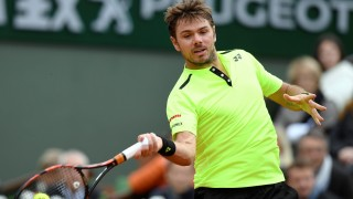 Switzerland's Stanislas Wawrinka returns the ball to Czech Republic's Lukas Rosol during their men's first round match at the Roland Garros 2016 French Tennis Open in Paris on May 23, 2016. / AFP PHOTO / MIGUEL MEDINA