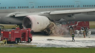A Korean Air Boeing 777 is seen on a runway in Tokyo's Haneda Airport on May 27, 2016.    About 300 passengers and crew members were evacuated from the plane after one of the engines caught fire, official said on May 27. / AFP PHOTO / KAZUHIRO NOGI