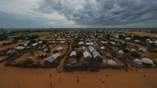 (FILES) This file photo taken on April 28, 2015 shows an overview of the eastern sector of the IFO-2 camp in the sprawling Dadaab refugee camp, some 470 kilometers north-east of the Kenyan capital Nairobi. Kenya is to send Somali refugees in the world's largest camp back to their war-torn country or third nations by November, the interior minister said on May 31, 2016. The sprawling Dadaab camp on the Kenya-Somalia border hosts some 350,000 refugees, the vast majority of whom fled Somalia's more than two-decade long conflict.  / AFP PHOTO / TONY KARUMBA