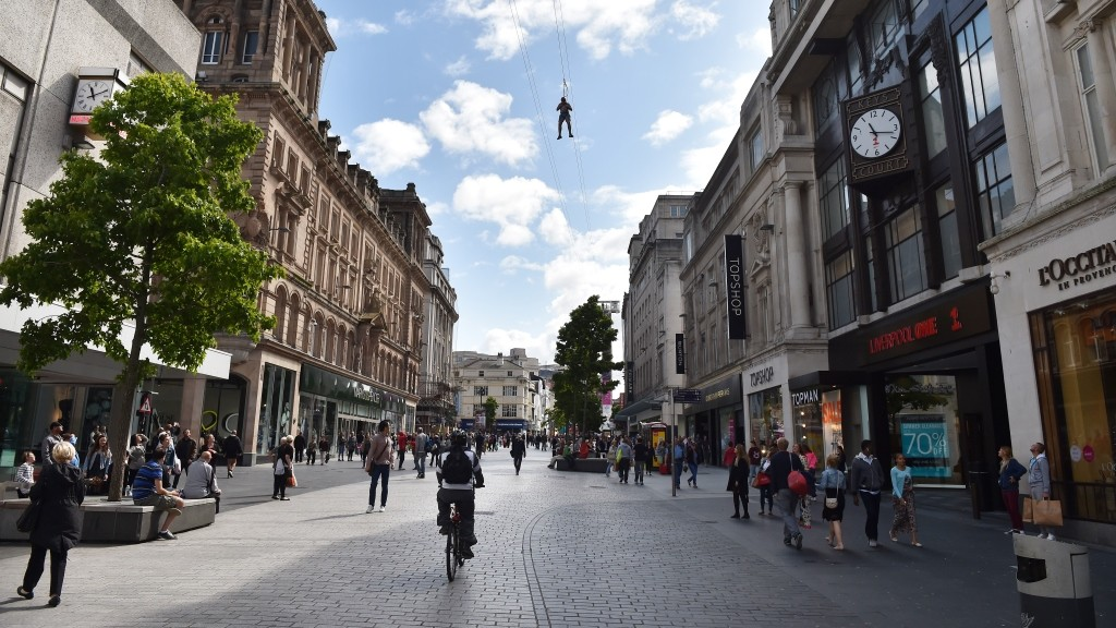 A member of the public rides a zip wire that has been built above one of the main shopping streets in Liverpool, north-west England on August 11, 2014. The 1000ft long wire will be open until September 7. AFP PHOTO / PAUL ELLIS / AFP PHOTO / PAUL ELLIS