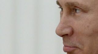 Russian President Vladimir Putin reacts during a meeting with Simon Bartley, president of WorldSkills International (WSI), (unseen) at the Kremlin on March 24, 2015. AFP PHOTO / YURI KADOBNOV / AFP PHOTO / YURI KADOBNOV